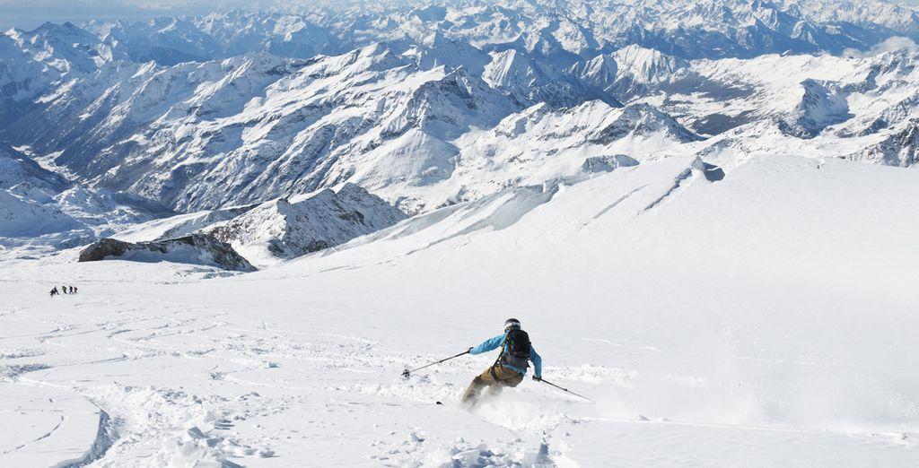 Diviértete practicando esquí o snowboard en Courmayeur