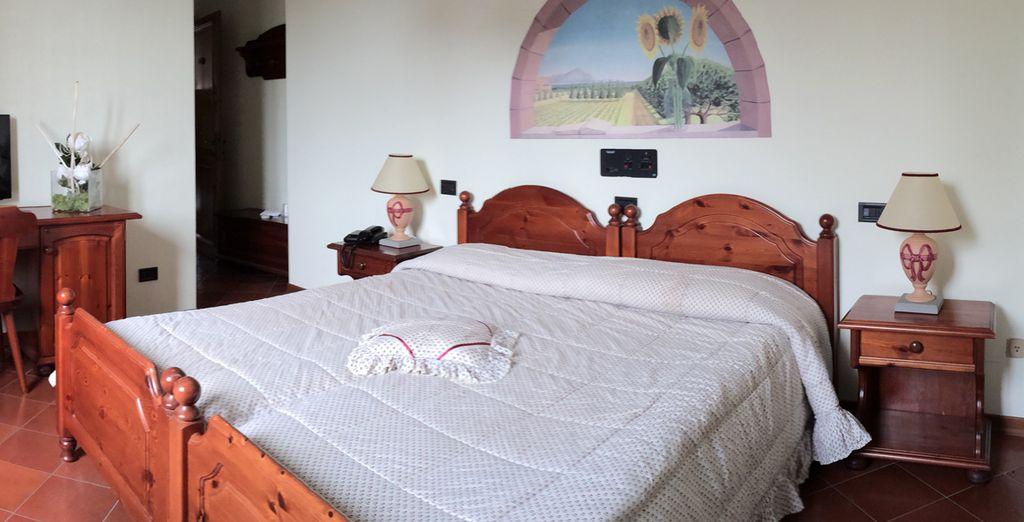 Descanse en su habitación confort clásica y vuelva a través del tiempo al estilo de Umbría en un ambiente cálido y familiar