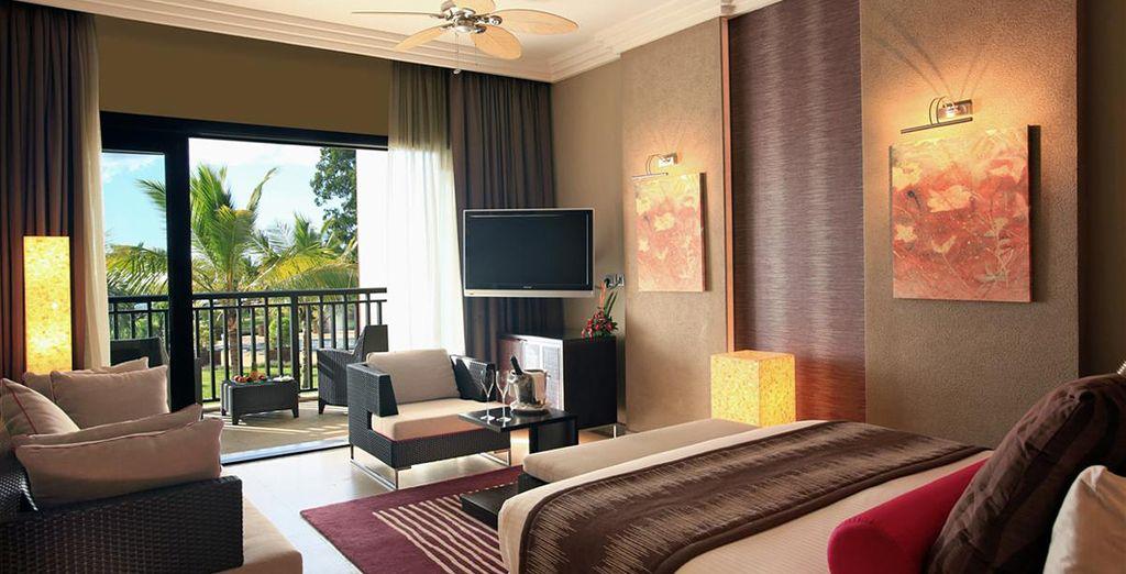 Podrás elegir alojarte en una habitación Deluxe con vistas al mar...