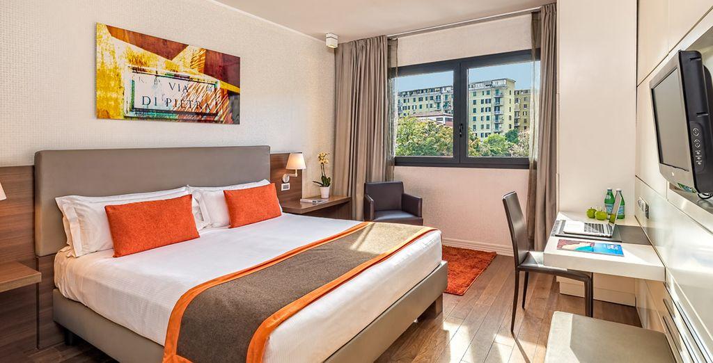 Las luminosas habitaciones del H10 Roma Città cuentan con una decoración elegante y funcional