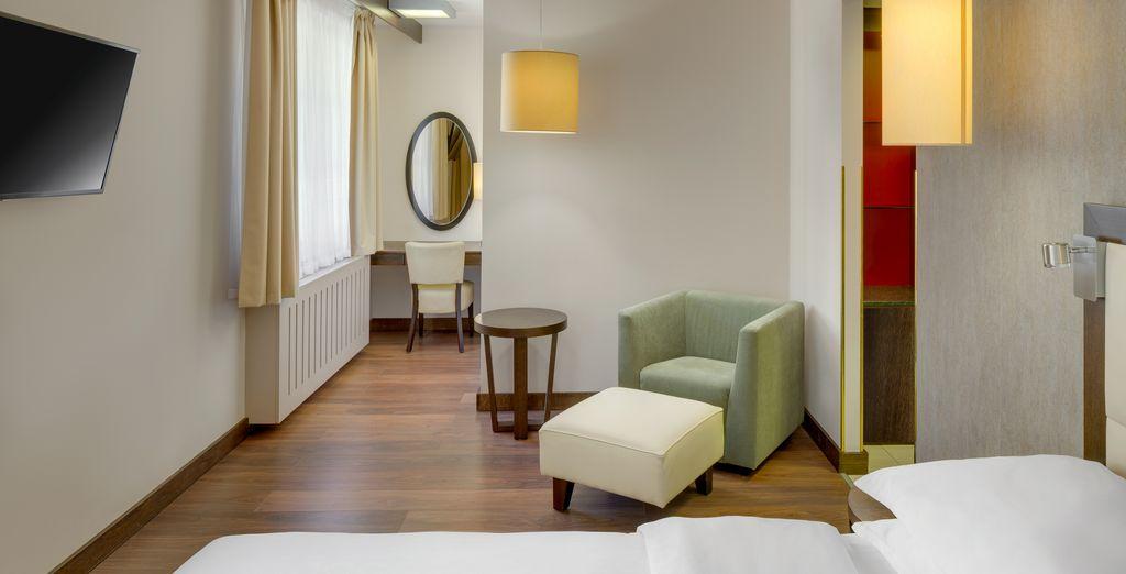 Descansa en tu habitación Grand Deluxe, elegante y cómoda