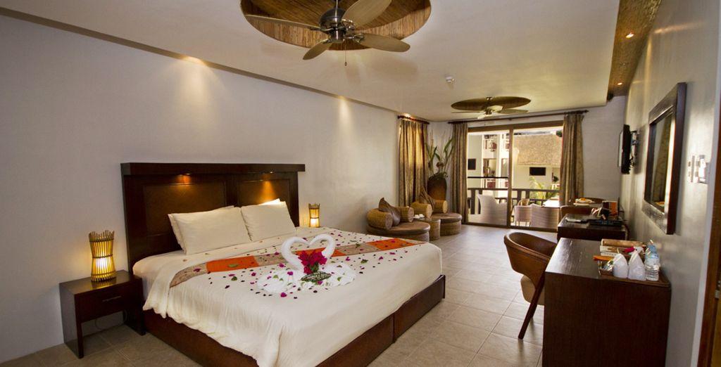 Descanase en su habitación del Hotel Ambassador