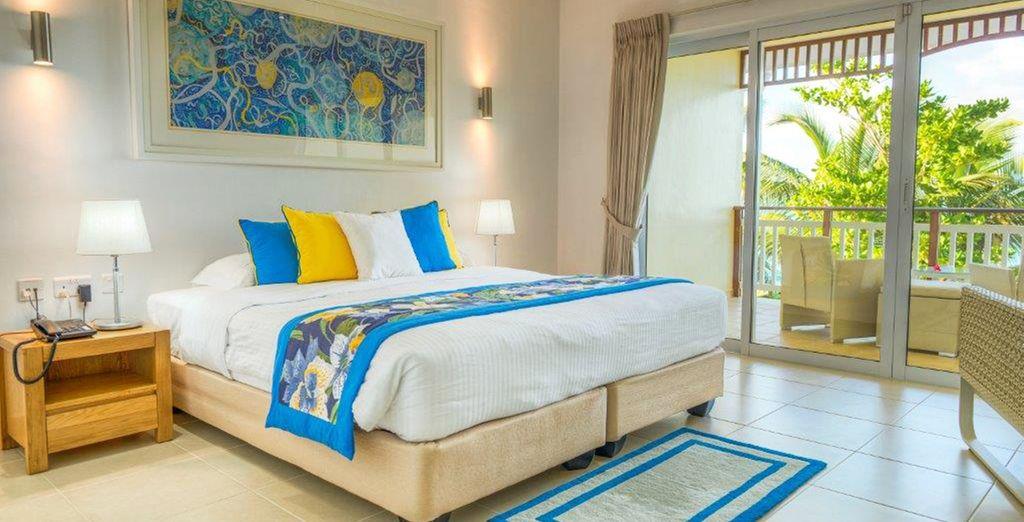 Ou préférez le cadre lumineux et coloré de la chambre Deluxe