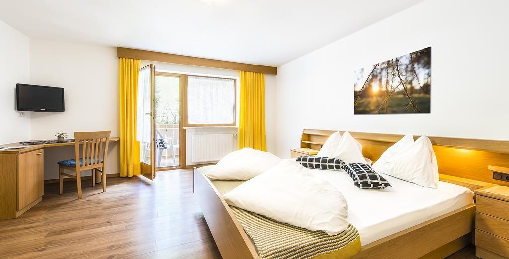 Hotel di alta gamma a Bolzano con un comodo letto e vicino alle piste da sci