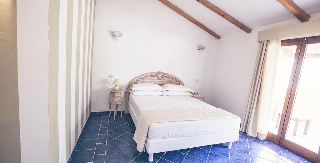 Riposerete in luminose camere standard con balcone