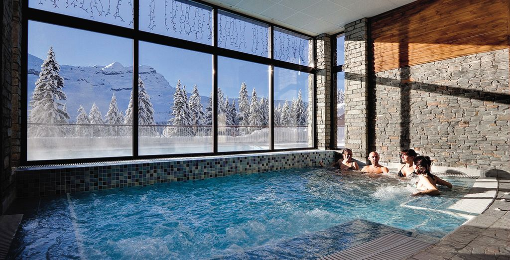 Relax in the indoor or outdoor hot tub to ease tired muscles