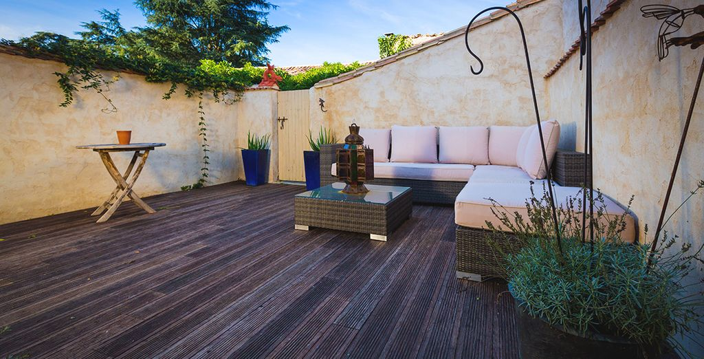 Unwind on the terrace, furnished with plush sofas