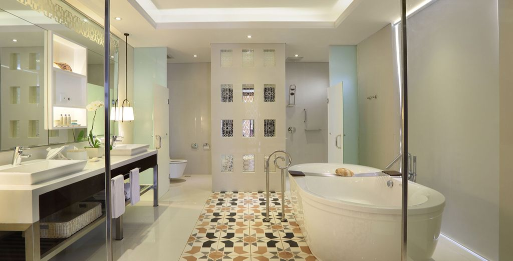 An expansive, modern bathroom, well-equipped