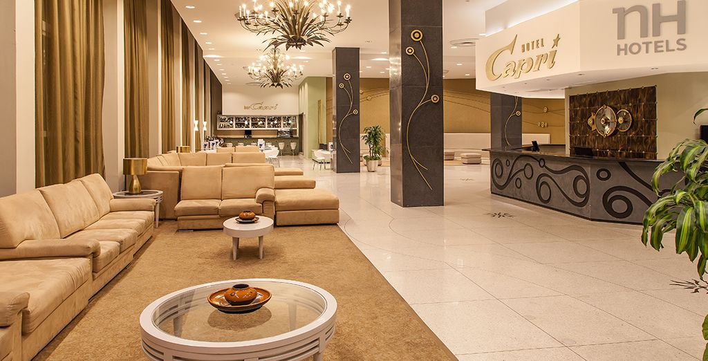 Start by staying at the NH Capri