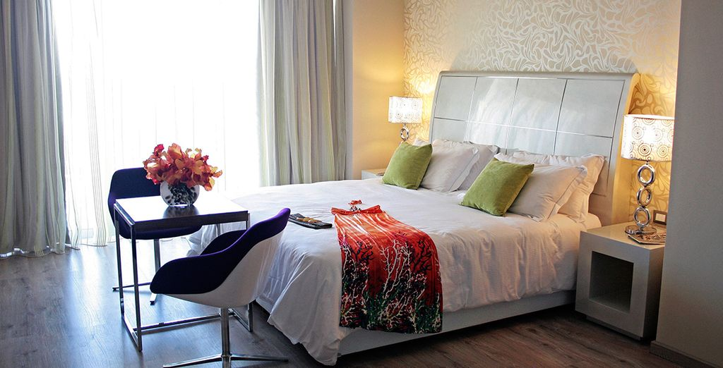 Stay in an elegant Deluxe Room with sea views