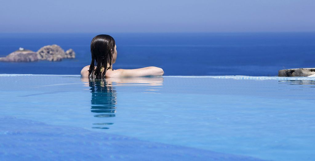 Look out over the crystal-clear waters of the Aegean Sea