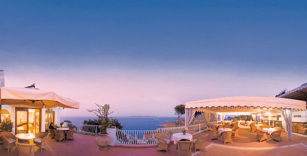 After a day out exploring, return to watch the sunset with a drink on the terrace