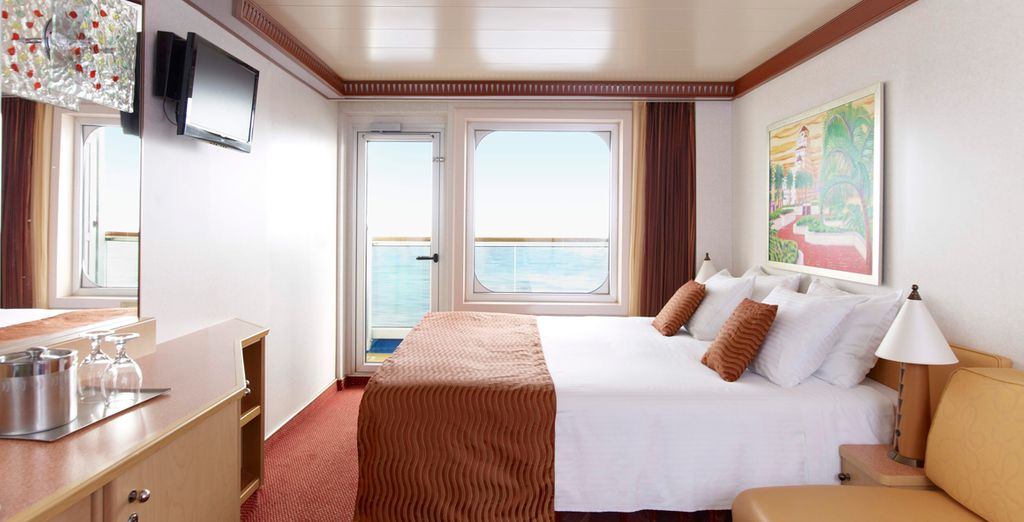 With a choice of luxurious staterooms...