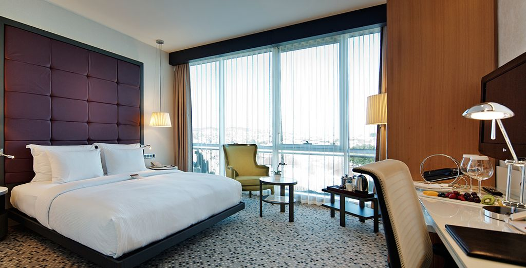 Stay in a chic and modern Deluxe Sea View Room