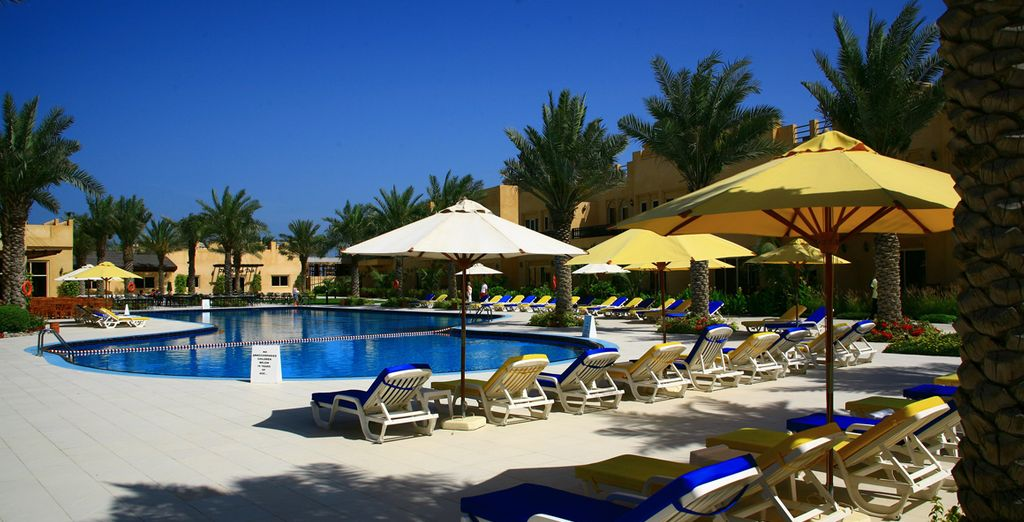 Top up your tan on a sun lounger by the pool