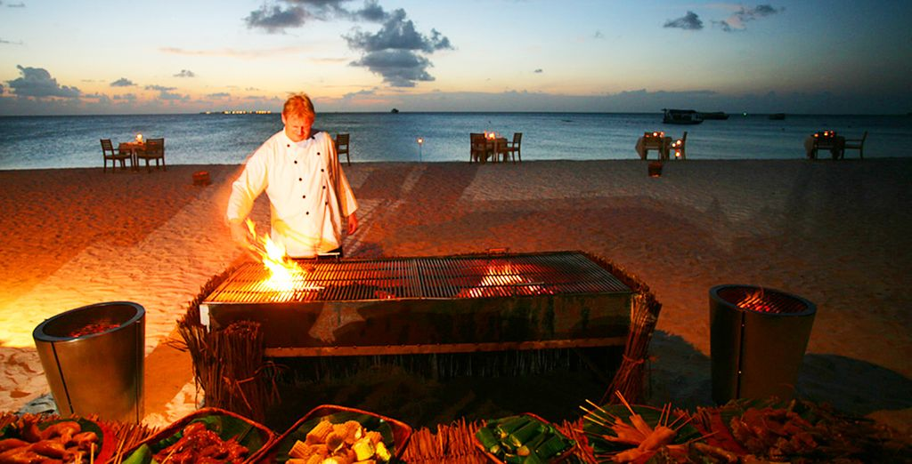 Enjoy a BBQ on the beach with a romantic sunset as a backdrop