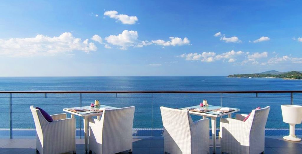 Sip a cocktail while watching the ocean