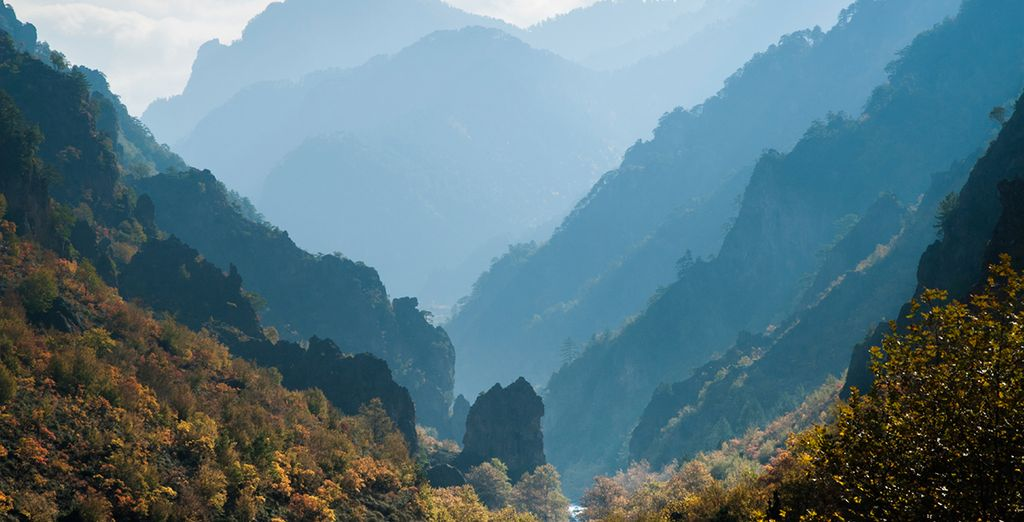 Surrounded by magnificent mountains, cliffs, valleys...