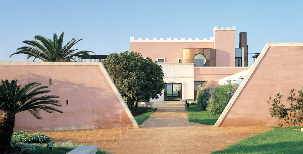 Approach the soft, pink structure of Grand Hotel Masseria Santa Lucia - Grand Hotel Masseria Santa Lucia 4* Ostuni