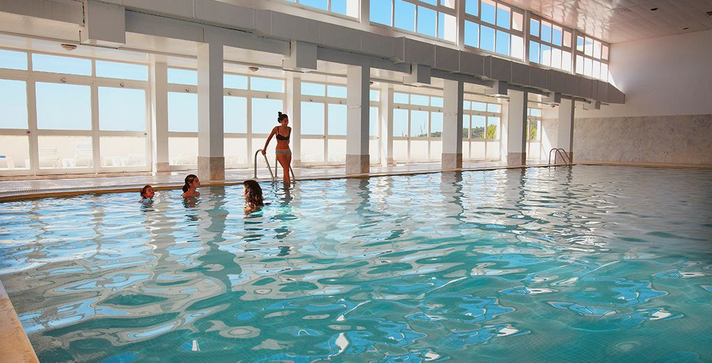 Cool off in the indoor pool with great views of the beach