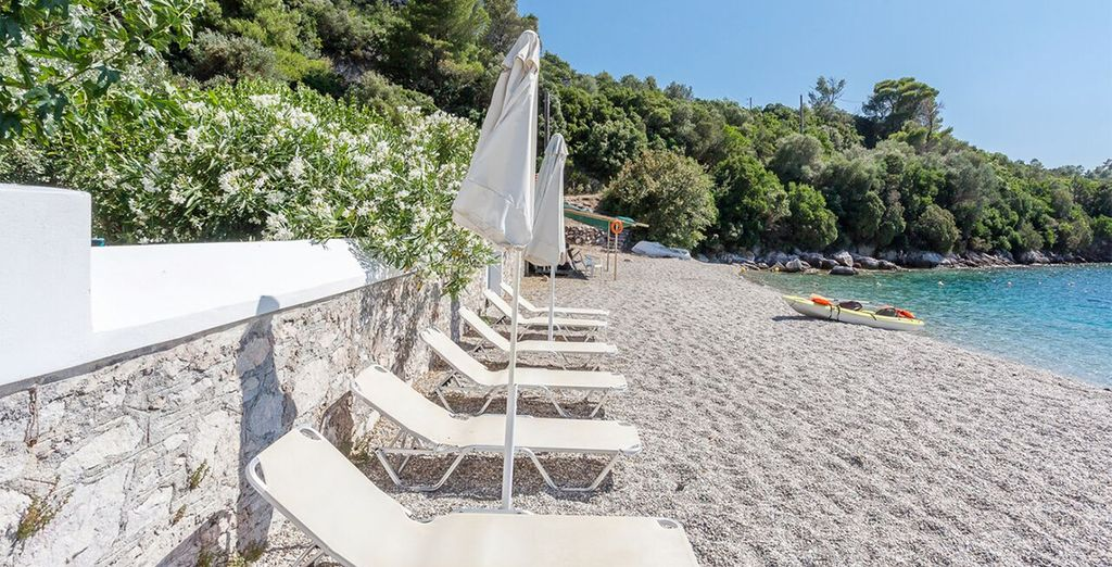 Where sunloungers lie facing the sparkling blue sea