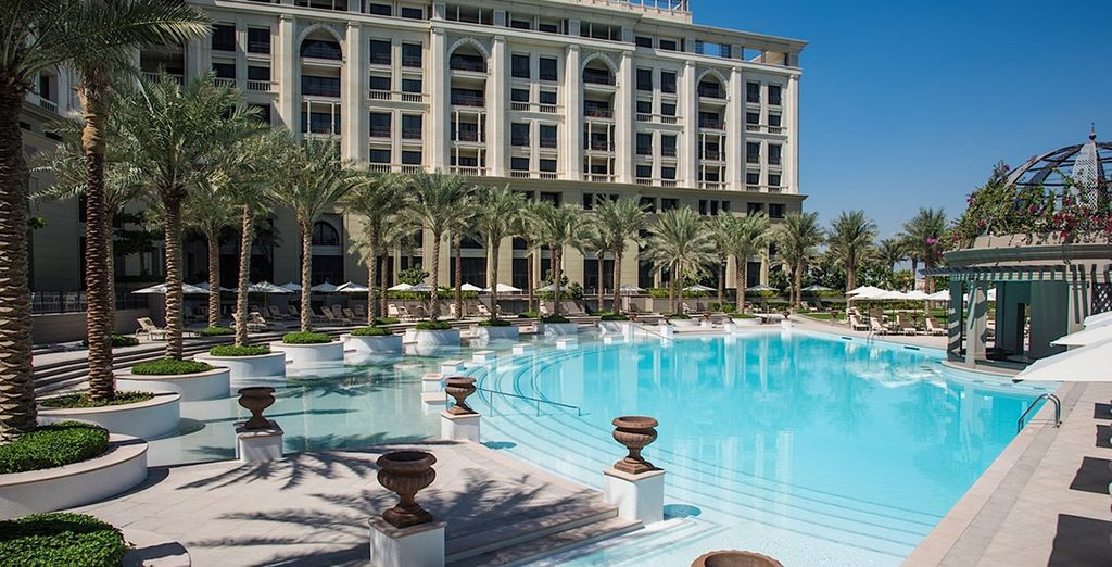 Doze in the sun by the palm-lined pool