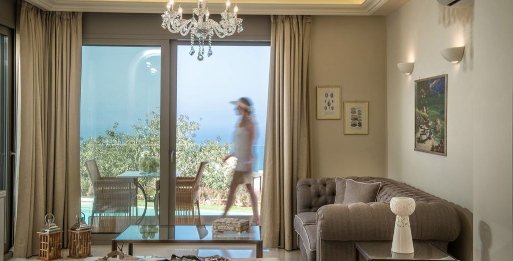 With an elegantly decorated living room looking out towards the Aegean