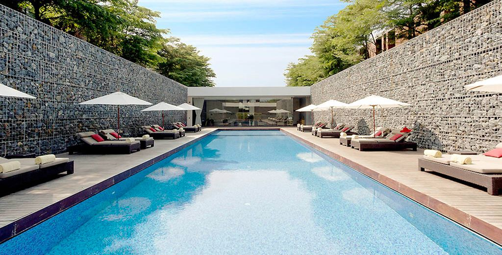 Soak up the sunshine by one of the two pools...