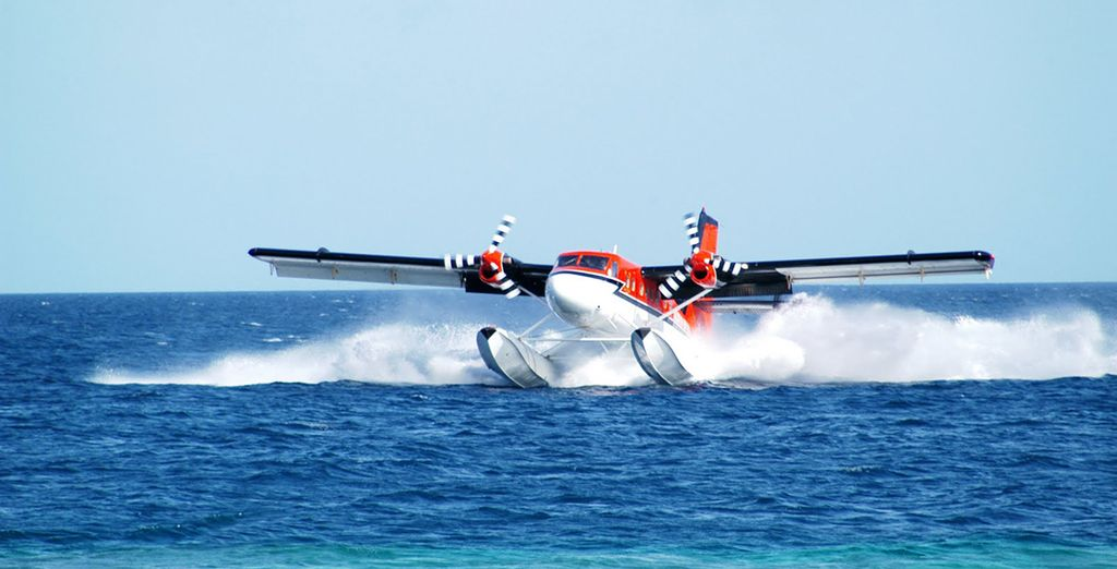 Arrive to your island by seaplane...