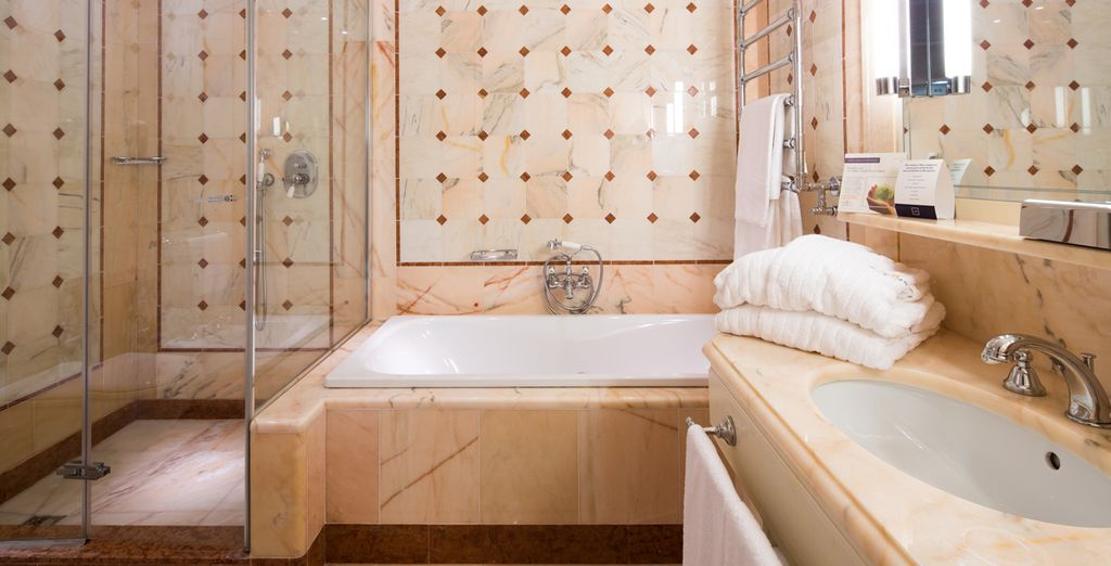 Complete with a rich, marble bathroom