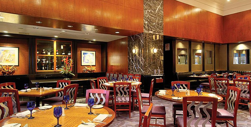And enjoy classic American dishes and cocktails at Charlotte's Restaurant