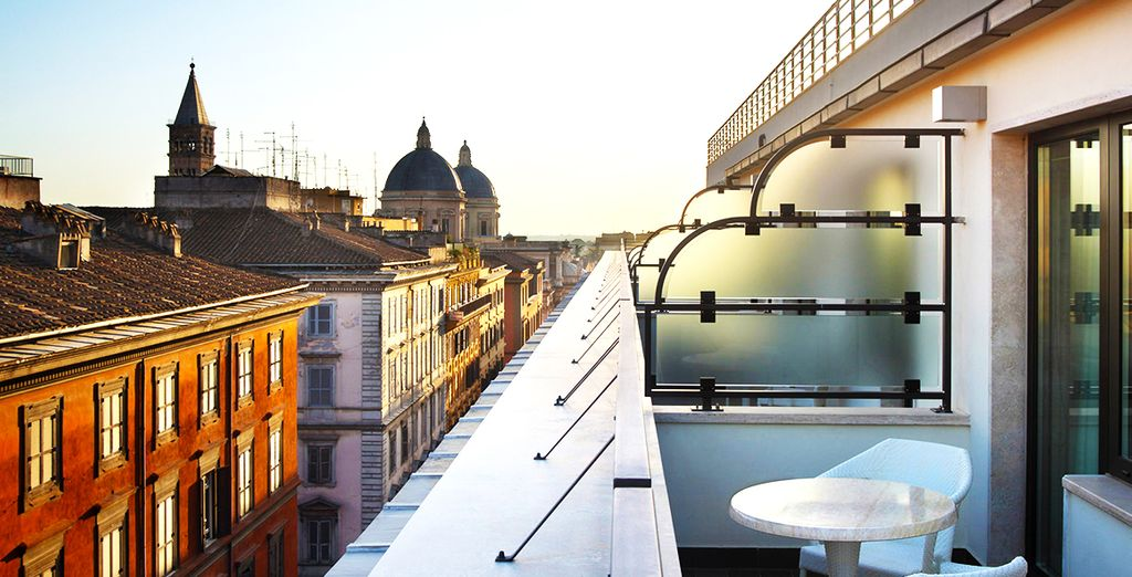 Soak up the sun on the terrace overlooking Rome's bustling streets