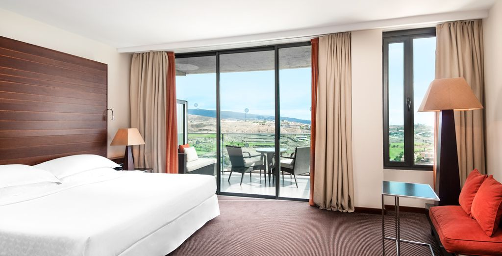 Stay in a spacious Deluxe room...