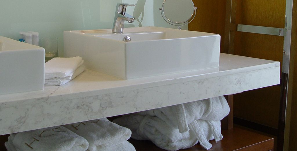 Which features a plush bathroom, with his & hers sinks