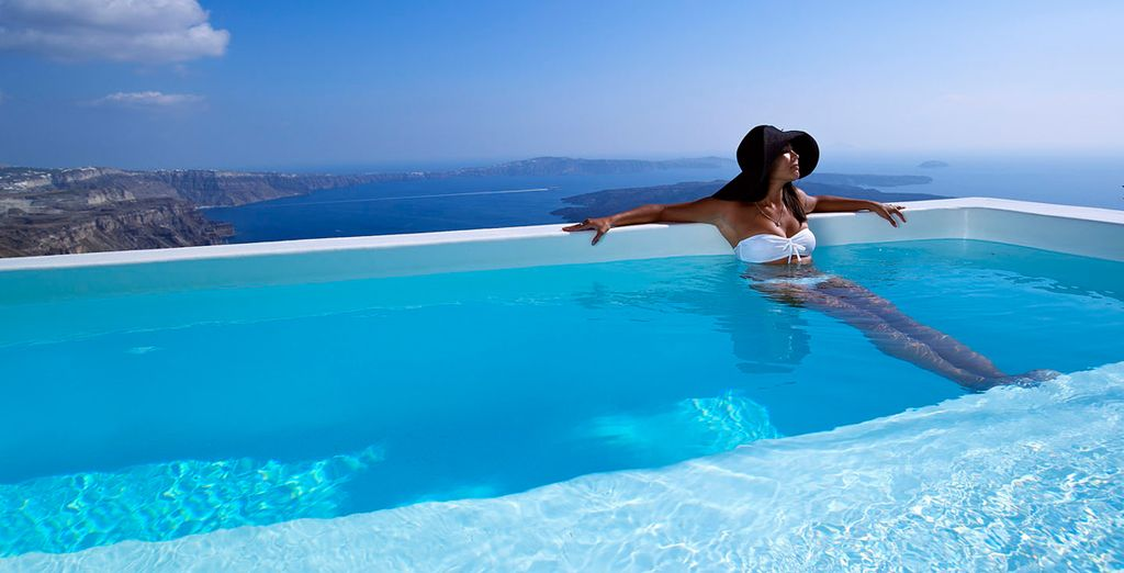 Enjoy a spectacular caldera cliff viewpoint from the pool