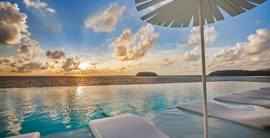Watch the sunset from the main pool
