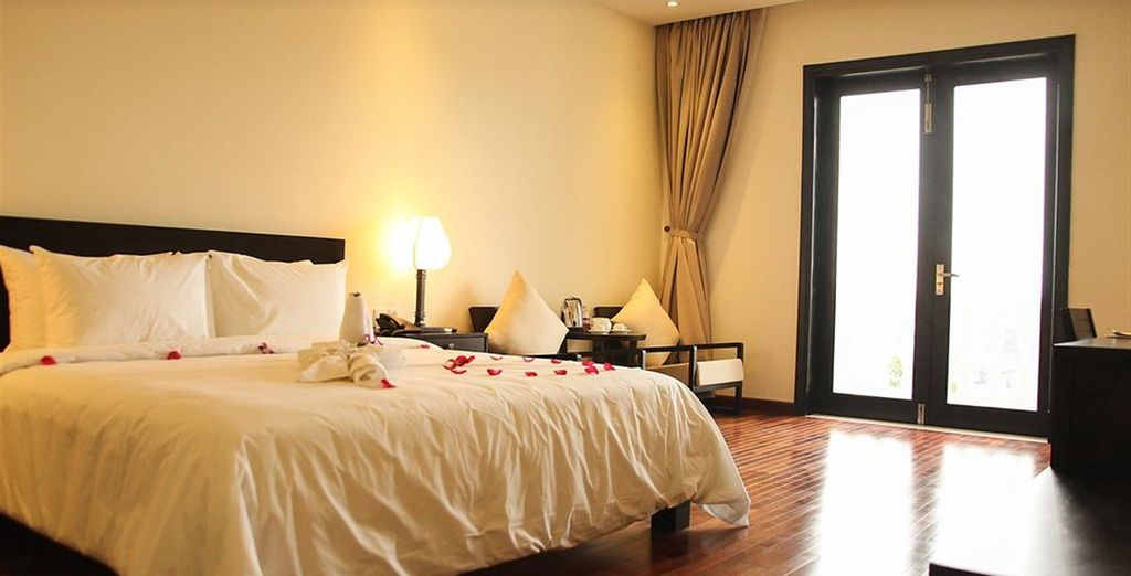 Where you'll enjoy a Deluxe Room with views of the river