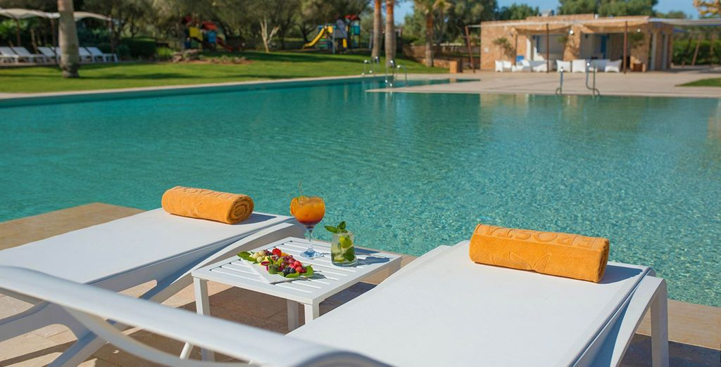 The pool is lined with sunloungers