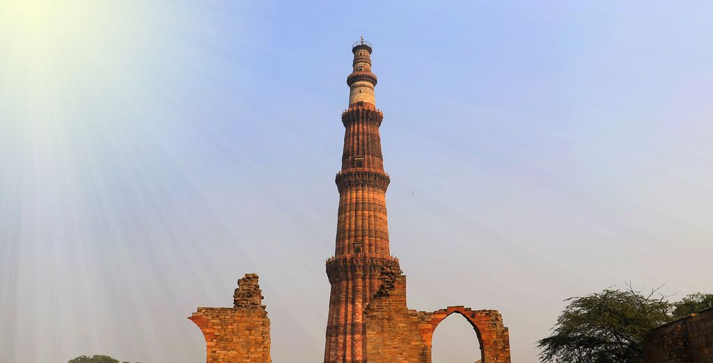 Take a photo by the Qutub Minar, a 72 metre Minaret