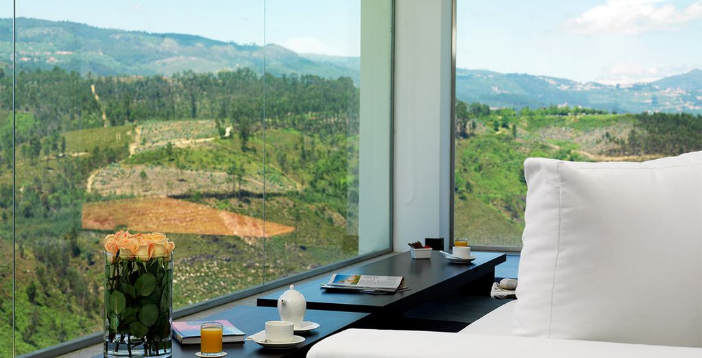 Where floor-to-ceiling windows beckon the gorgeous scenery in
