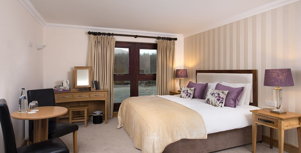 Or a comfortable Deluxe Room