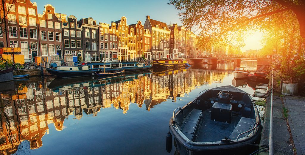 Delve into the winding canals of Amsterdam