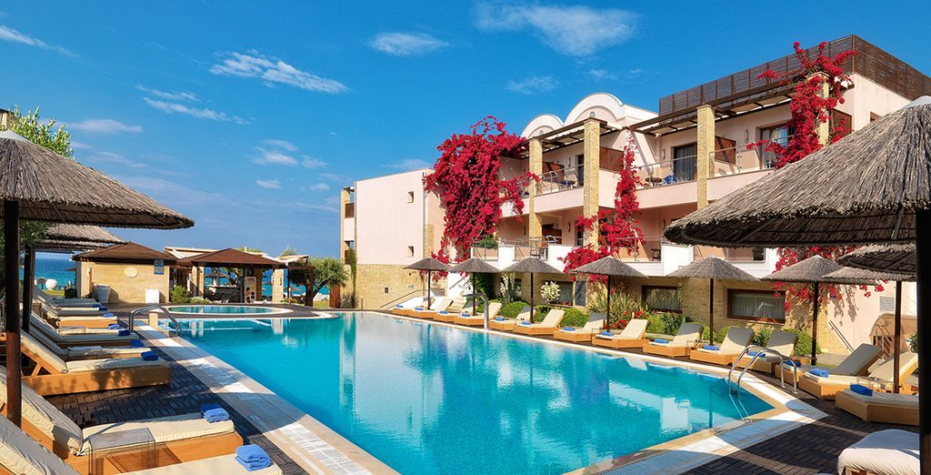 Enjoy a turquoise outdoor pool and whitewashed buildings