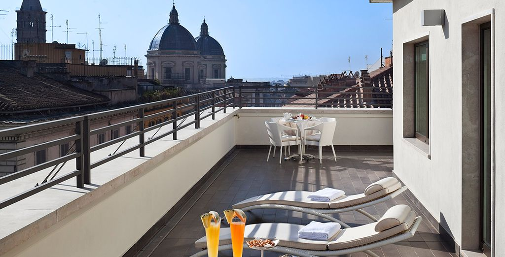 Or soak up the sun on the terrace overlooking Rome's bustling streets