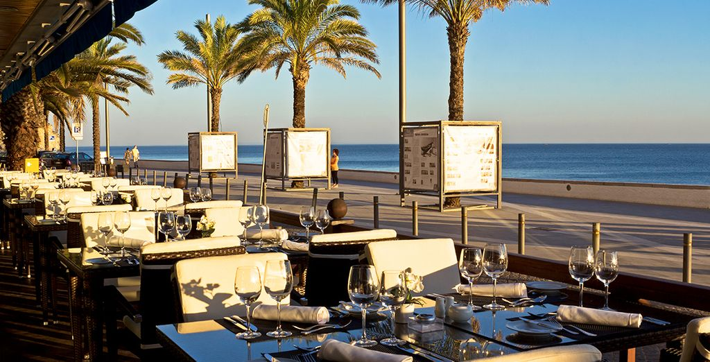 Indulge in the superb restaurant beside the beach