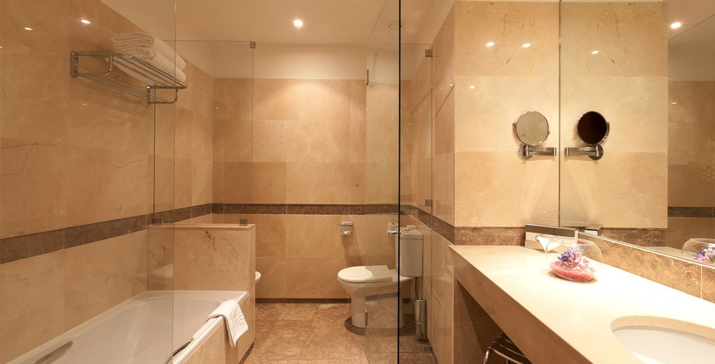 With a luxurious marble bathroom