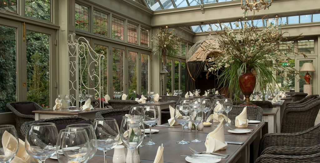 Dine in style at the hotel's chic restaurant, where light cascades in through its signature glass ceiling