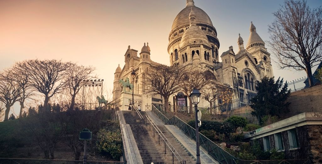 Head up to the striking Sacré-Cœur
