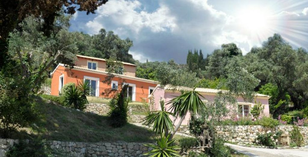 The hotel is scattered amphitheatrically across the slopes of a green hill, amidst the olive groves