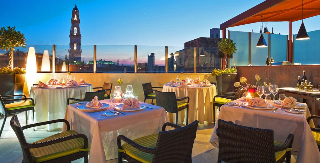 Admire stunning views from the rooftop restaurant...